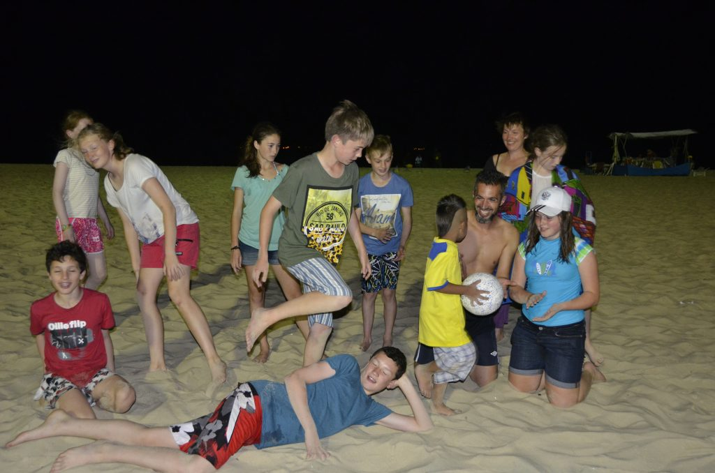 LFI Brasilia 2014 players on Copacabana Beach at night